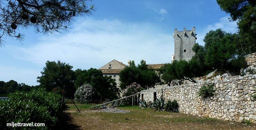 Olive grove and garden with Tower and walls of the Monastery