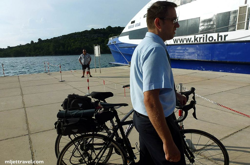 two bikes in Pomena port waiting to be embarked on Kilo Star fast ferry